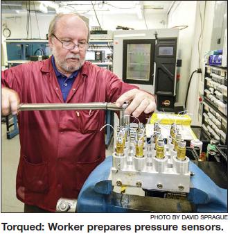 Hydra-Electric worker prepares pressure sensors